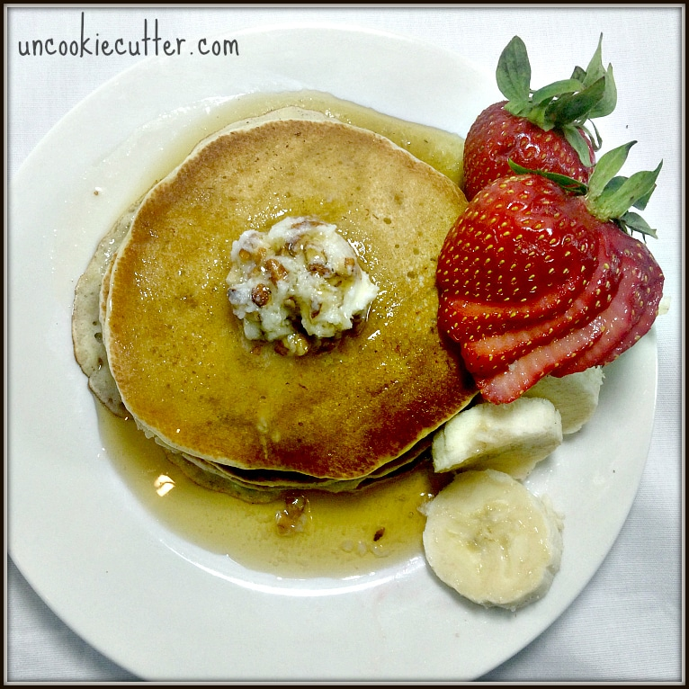 """Banana Pancakes with Cinnamon and Honey Pecan Butter - My husband dubbed these """"The best pancakes he ever had"""". They were fantastic and uses mashed banana cuts down on the fat! The honey pecan butter was the perfect touch! UncookieCutter.com"""