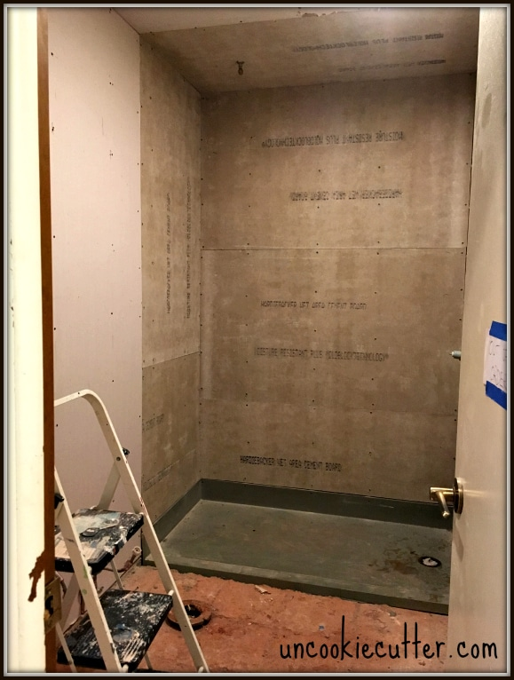 How I replaced my old tub/shower combo with a fancy new walk-in, seamless entry shower with wood grain tile. UncookieCutter.com