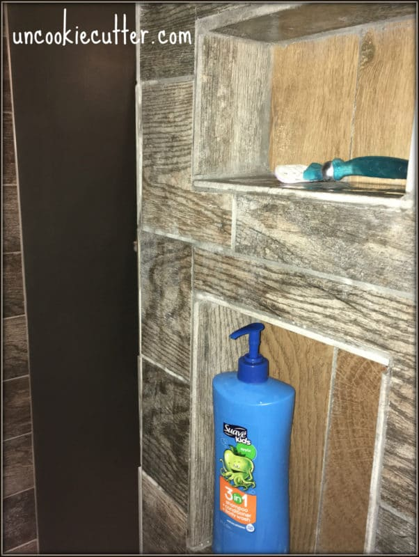 How I added a shower nook in our new seamless entry, walk-in shower. UncookieCutter.com